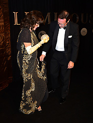 Dame Joan Collins and Percy Gibson attending the BFI Luminous Fundraising Gala held at the Guildhall, London.