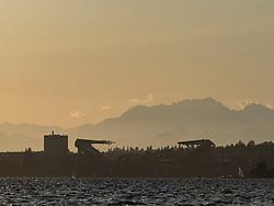 United States, Washington, Seattle, Husky Stadium and the Olympic Mountains at sunset, from Lake Washington
