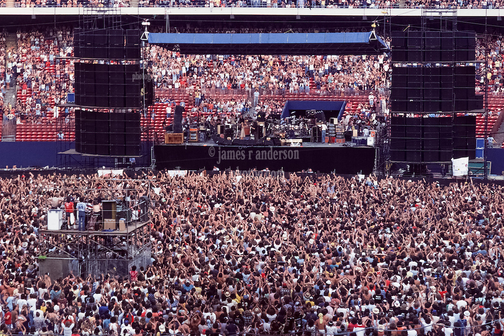 The Grateful Dead Live at Giants Stadium 02 September 1978. View of the Sound System, Stage, Audience and Band from the back of the Venue.