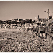 I suspect that this view hasn't changed in over thirty years.  The long view down the seawall just seems to keep going, but never changing.  The sepia treatment helps to create an antique feel.