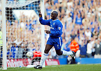 Photograph: Scott Heavey.<br />Chelsea v Tottenham Hotspur from Stamford Bridge. 13/09/2003.<br />Jimmy Floyd Hasselbaink celebrates his 1st and Chelsea's 4th