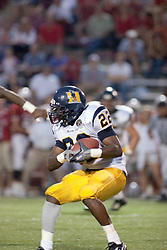 24 SEP 2005<br /> <br /> Racers Running Back Nick Turner protects the ball as he looks for a way up the field.<br /> <br /> The Illinois State University Redbirds were victorious with a shut out score of 42 - 0 over Murray State Racers during the Hall of Fame Game held at Hancock Stadium on Illinois State University campus in Normal IL