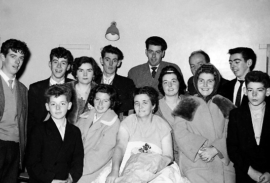 Mrs Maguire, (with bouquet), surrounded by other members of her family, celebrates the arrival of her 20th baby at the Rotunda Hospital. Even for its time, this was an unusually large family, and the event made the British as well as the Irish papers..09.10.1960
