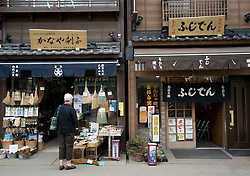 Exterior view of traditional old wooden shop houses in historic Asakusa district of Tokyo Japan