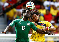 June 19, 2014  Brasilia, Brazil. Cote d'Ivoire's Wilfried Bony (L) competes for a header with Colombia's Abel Aguilar during a Group C match between Colombia and Cote d'Ivoire of 2014 FIFA World Cup at the Estadio Nacional Stadium in Brasilia, Brazil, June 19, 2014. Colombia won 2-1 over Cote d'Ivoire. (Credit Image: © Xinhua via ZUMA Wire)