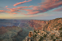 Clouds glowing in the last rays of setting sun over Navajo Point, Grand Canyon National Park