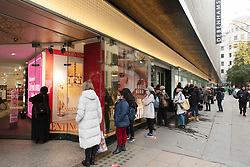 © Licensed to London News Pictures. 02/12/2020. London, UK. Shoppers queue outside Debenhams department store in Oxford Street after announce a fire sale to get rid of stock. The company amounted yesterday it was to close all of its Uk stores with the up to 12,000 job losses. Photo credit: Ray Tang/LNP