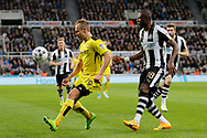 Burton Albion striker Luke Varney (19) and Newcastle United defender Chancel Mbemba (18) during the EFL Sky Bet Championship match between Newcastle United and Burton Albion at St. James's Park, Newcastle, England on 5 April 2017. Photo by Richard Holmes.