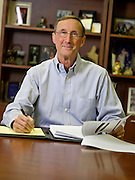 George Faucette sits in his office on Thursday, Dec. 12, 2013, in Fayetteville, Ark. Photo by Beth Hall