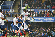 Wycombe Wanderers Defender, Sido Jombati (2) wins a header during the EFL Sky Bet League 1 match between Portsmouth and Wycombe Wanderers at Fratton Park, Portsmouth, England on 22 September 2018.