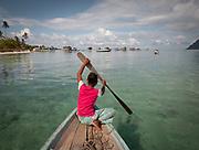 Alpaida visiting stilt houses. Bajau family living all year round on a Lepa, a traditional houseboat. Off Maiga island.