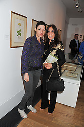 Left to right, MARY McCARTNEY and OLIVIA HARRISON at a private view of work by the late Rory McEwen - The Colours of Reality, held at the Shirley Sherwood Gallery, Kew Gardens, London on 20th May 2013.