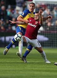 West Ham United's Jack Wilshere and Southampton's Oriol Romeu battle for the ball