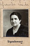 a 1939 identity portrait image of adult woman on document France