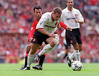 Chris Makin (Sunderland) and Ryan Giggs (Man Utd). Manchester United v Sunderland. FA Premiership, 9/9/00. Credit Colorsport / Nick Kidd.