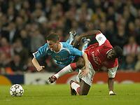 Photo: Olly Greenwood.<br />Arsenal v PSV Eindhoven. UEFA Champions League. Last 16, 2nd Leg. 07/03/2007. Arsenal's Kolo Toure tackles PSV's Jason Culina