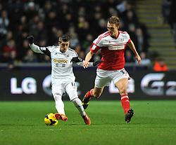 Swansea City's Pablo Hernandez shields the ball from Fulham's Dan Burn - Photo mandatory by-line: Alex James/JMP - Tel: Mobile: 07966 386802 28/01/2014 - SPORT - FOOTBALL - Liberty Stadium - Swansea - Swansea City v Fulham - Barclays Premier League