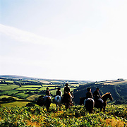 Followers of the Devon and Somerset Staghounds, Exmoor, Somerset, UK. Stag hunting is an activity involving the tracking, chase and sometimes killing of a stag by trained hounds and a group of followers lead by a 'master' who follow the hounds on foot or on horseback. This controversial sport, was banned in England and Wales in November 2004.