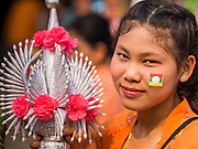 "05 APRIL 2015 - CHIANG MAI, CHIANG MAI, THAILAND: Tai Yai women march in a parade for boys being ordained as Buddhist novices during the second day of the three day long Poi Song Long Festival in Chiang Mai. The Poi Sang Long Festival (also called Poy Sang Long) is an ordination ceremony for Tai (also and commonly called Shan, though they prefer Tai) boys in the Shan State of Myanmar (Burma) and in Shan communities in western Thailand. Most Tai boys go into the monastery as novice monks at some point between the ages of seven and fourteen. This year seven boys were ordained at the Poi Sang Long ceremony at Wat Pa Pao in Chiang Mai. Poy Song Long is Tai (Shan) for ""Festival of the Jewel (or Crystal) Sons.    PHOTO BY JACK KURTZ"