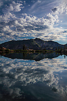 Clouds refelct in the calm waters of Cecret Lake in Utah's Wasatch Mountains