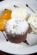 Vanilla Volcano cake with cream and peaches