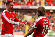 Charlton Athletic midfielder Ricky Holmes (11) and Charlton Athletic forward Lee Novak (30) celebrate a goal during the EFL Sky Bet League 1 match between Charlton Athletic and Coventry City at The Valley, London, England on 15 October 2016. Photo by Andy Walter.