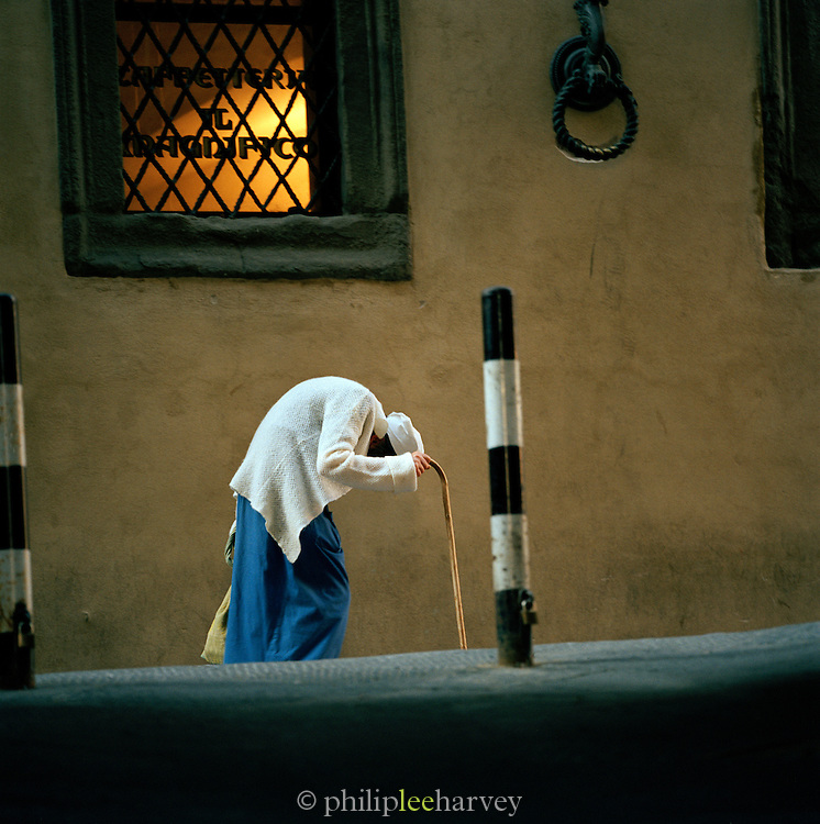 Portrait of elderly lady in the old town, Siena, Tuscany, Italy