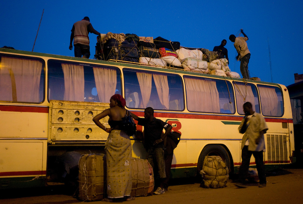 People loading a bus at Mopti's bus station. At the confluence of the Niger and the Bani rivers, between Timbuktu and Segou, Mopti is the second largest city in Mali, and the hub for commerce and tourism in this west-african landlocked country.