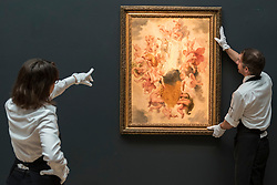 "© Licensed to London News Pictures. 01/07/2016. London, UK.  Technicians prepare to hang an oil study called ""The Chariot of Apollo"" by Sir Peter Paul Rubens (est. GBP 1-1.5 million), which has never been seen on public display since 1823, at the preview of Sotheby's London Old Masters evening sale which takes place 6 July.   Photo credit : Stephen Chung/LNP"