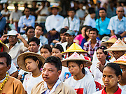 06 NOVEMBER 2015 - YANGON, MYANMAR: People at the final NDF election rally of the 2015 election. The rally was held in central Yangon, next to the historic Sule Pagoda and across the street from Yangon city hall. The National Democratic Force (NDF) was formed by former members of the National League for Democracy (NLD) who chose to contest the 2010 general election in Myanmar because the NLD boycotted that election. There have been mass defections from the NFD this year because many of the people who joined the NFD in 2010 have gone back to the NLD, which is contesting this year's election and widely expected to win it. Campaigning in the Myanmar election ended Friday. People go to the polls Sunday.     PHOTO BY JACK KURTZ
