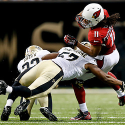 Sep 22, 2013; New Orleans, LA, USA; New Orleans Saints outside linebacker David Hawthorne (57) tackles Arizona Cardinals wide receiver Larry Fitzgerald (11) during a game at Mercedes-Benz Superdome. The Saints defeated the Cardinals 31-7. Mandatory Credit: Derick E. Hingle-USA TODAY Sports