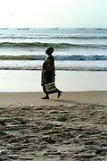 Woman walking on Dakar Beach
