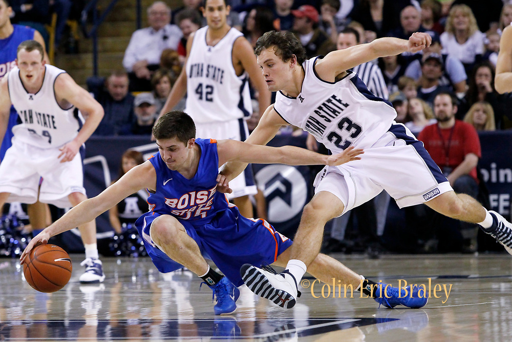 Boise State forward Paul Noonan (25) and Utah State guard Brian Green (23)go after a loose ball during the first half of an NCAA college basketball game in Logan, Utah, Saturday, Feb. 5, 2011. (AP Photo/Colin E Braley)