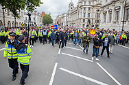 Police lead during the Football Lads Alliance march between Park Lane and Westminster Bridge, London on 7 October 2017. Photo by Phil Duncan.