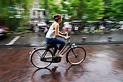 Fietsers rijden door de regen in Utrecht.<br /> <br /> Cyclists are riding in the rain in Utrecht.