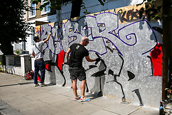 © Licensed to London News Pictures. 24/08/2019. London, UK. Graffiti artists graffiti on the boards up ahead of the 2019 Notting Hill Carnival which takes place this weekend and on bank holiday Monday. Up to 1 million people are expected to attend the biggest street party in Europe. Photo credit: Dinendra Haria/LNP