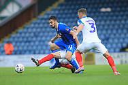 Ben Thompson challenges Jordan Williams  during the The FA Cup 2nd round match between Rochdale and Portsmouth at Spotland, Rochdale, England on 2 December 2018.