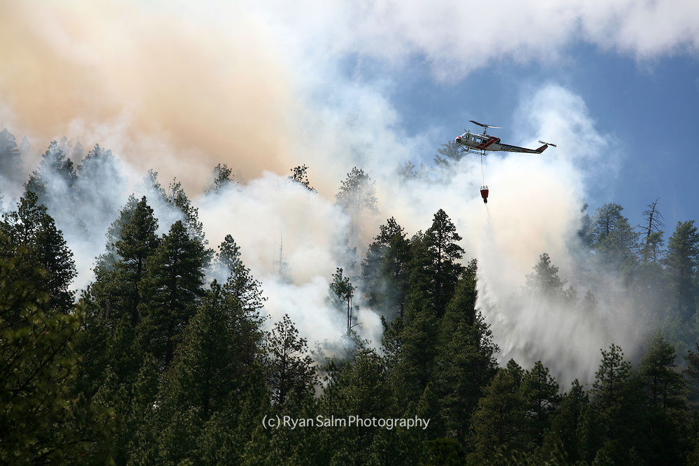 A helicopter drops water on a fire in Lake Tahoe.