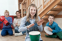 Group of drumming children