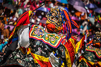 THIMPU, BHUTAN - CIRCA OCTOBER 2014: Mask performer dancing during the Tshechu Festival inl Bhutan