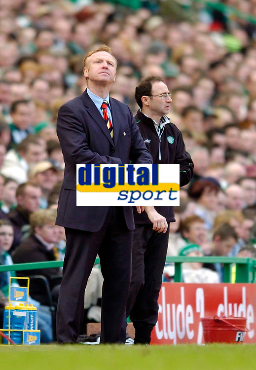 Photo. Jed Wee.Digitalsport<br /> Glasgow Celtic v Glasgow Rangers, Scottish FA Cup, Celtic Park, Glasgow. 07/03/2004.<br /> Rangers' manager Alex McLeish (L) wonders if time is up as his team's season comes to a premature end.