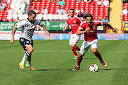 Charlton Athletic midfielder Ricky Holmes (11) battles for possession with Bolton Wanderers midfielder Jay Spearing (8) during the EFL Sky Bet Championship match between Charlton Athletic and Bolton Wanderers at The Valley, London, England on 27 August 2016. Photo by Matthew Redman.