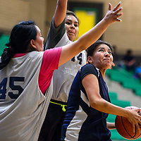 Alicia Smith, right, shoots under a block attempt by Vanessa Begay during the Don't Drink and Drive Peshlakai Angels basketball tournament in Newcomb Saturday.