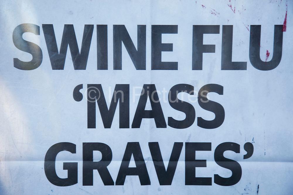 Sign on an Evening Standard newspaper stand warning of Swine Flu Mass Graves.