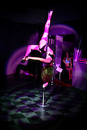 """27th July 2009. Los Angeles, California. In recent years, pole dancing has gained acceptance as a form of physical fitness and even a competition sport. The weekly showcase at Club Good Hurt in West Los Angeles represents the latest evolution in pole dancing's migration from the strip club to the mainstream performance venue. It features Southern California pole dancers performing to live rock music in a setting where, according to show producer Emilee Wilson, there's """"no tipping and no stripping."""".PHOTO © JOHN CHAPPLE / www.chapple.biz.tel +1 310 570 9100    john@chapple.biz"""