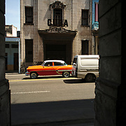 Cars passing by at Centro Havana