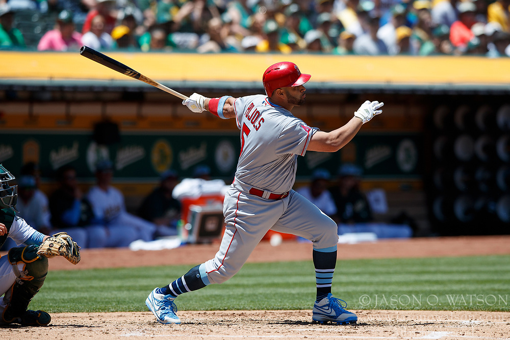 OAKLAND, CA - JUNE 17: Albert Pujols #5 of the Los Angeles Angels of Anaheim hits an RBI single against the Oakland Athletics during the third inning at the Oakland Coliseum on June 17, 2018 in Oakland, California. The Oakland Athletics defeated the Los Angeles Angels of Anaheim 6-5 in 11 innings. (Photo by Jason O. Watson/Getty Images) *** Local Caption *** Albert Pujols