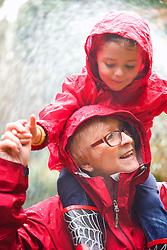 Grandmother Giving Piggyback Ride to Granddaughter