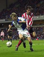 Photo. Glyn Thomas<br />Blackburn Rovers v Southampton. FA Barclaycard Premiership.<br />Ewood Park, Blackburn. 08-02-2003.<br />Southampton's Jo Tessom (R) tries to disposess Vratislav Gresko