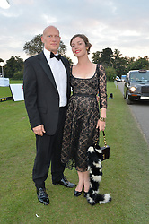 DOMINIC BURNS and CAMILLA RUTHERFORD at the Chovgan Twilight Polo Gala in association with the PNN Group held at Ham Polo Club, Petersham Close, Richmond, Surrey on 10th September 2014.